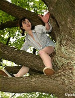 Girls climbing Hanging in tree