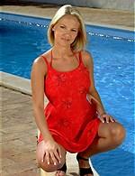 Fabulous blonde in red bikini by pool