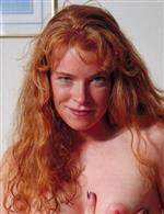 Who is this freckled Milf with red hair from auntjudys ?