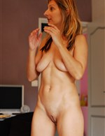 Who is this slender, tall, natural milf babe? Please Help!